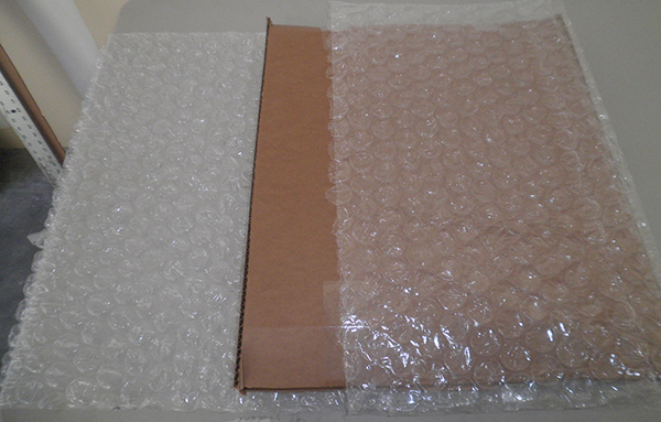 A Layer of Bubble Wrap Provides Extra Cushioning and Fills the Space Between the Inner and Outer Cardboard